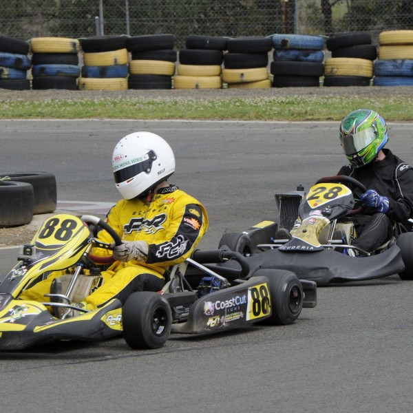 Two go-kart riders racing around the track