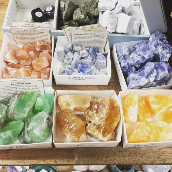 Forest of Wisdom coloured crystals with labels describing properties